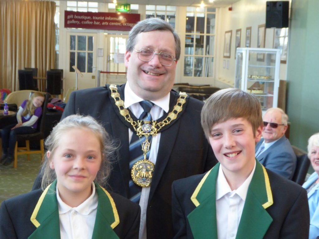 Sophie Hollinrake and Joshua Youd receiving a donation from the Mayoral Charity